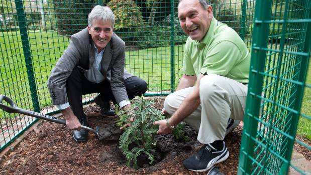 Tasman mayor Richard Kempthorne, left and Gardens of the World owner Francis Day plant a Wollemi Pine at the Gardens of ...