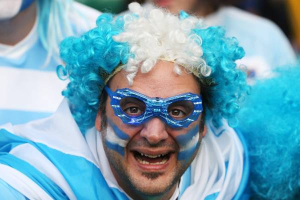 A Pumas fan waits for the big match to start at Twickenham.