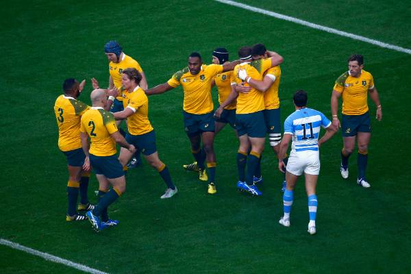 The Wallabies celebrate lock Rob Simmons' second minute try in the Rugby World Cup semifinal vs Argentina.