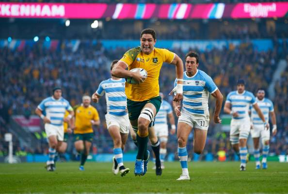Wallabies lock Rob Simmons runs for the try line after snaring an intercept.