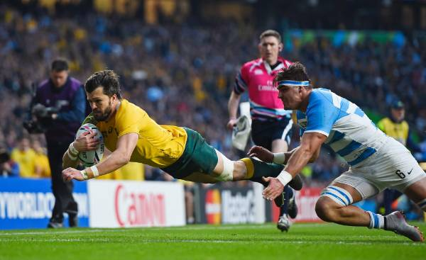 Wallabies wing Adam Ashley-Cooper dives in for the try.