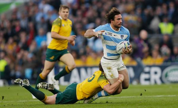 Wallabies first five-eighth Bernard Foley makes a try-saving tackle on Argentina's Marcelo Bosch during the Rugby World ...