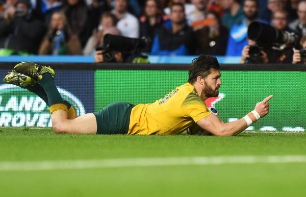 Wallabies wing Adam Ashley-Cooper dives over for his second try in the Rugby World Cup semifinal against Argentina.
