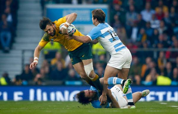 Wallabies wing Adam Ashley-Cooper is tackled by Argentina's Marcelo Bosch and Nicolas Sanchez.