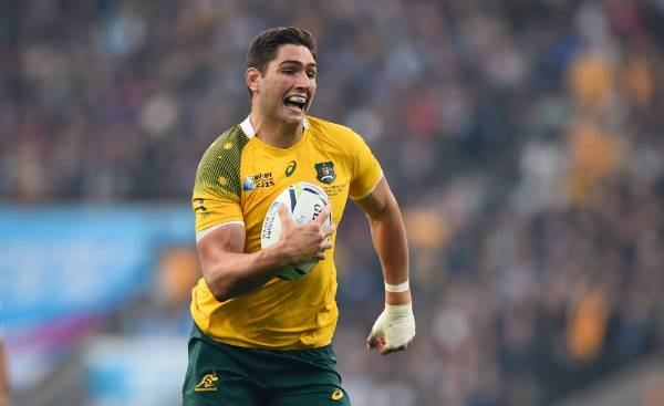 Australia's Rob Simmons scores the opening try in the opening minute.