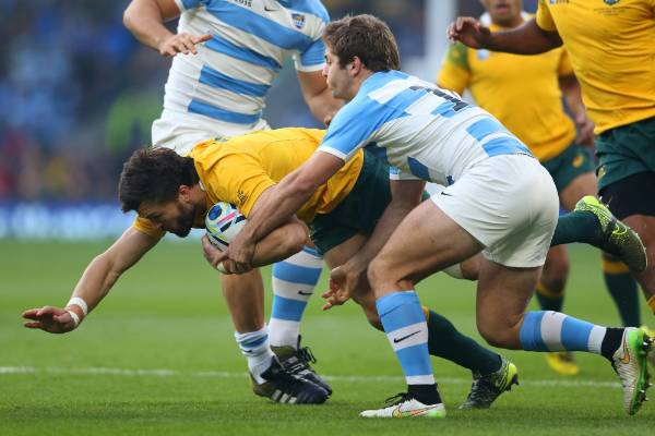 Wallabies wing Adam Ashley-Cooper is tackled by Argentina's Santiago Cordero.