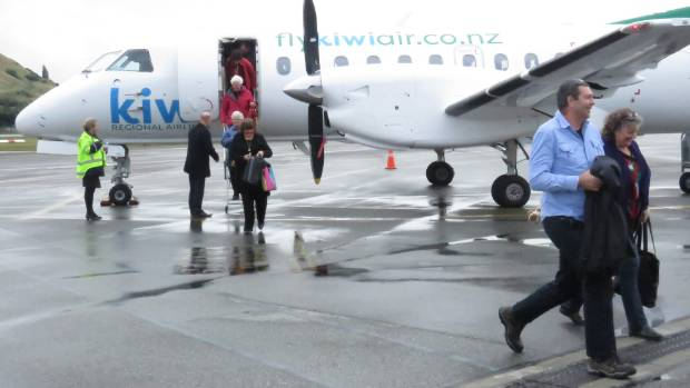 The first passengers on Kiwi Regional Airlines inaugural flight disembark at Queenstown Airport on Tuesday.