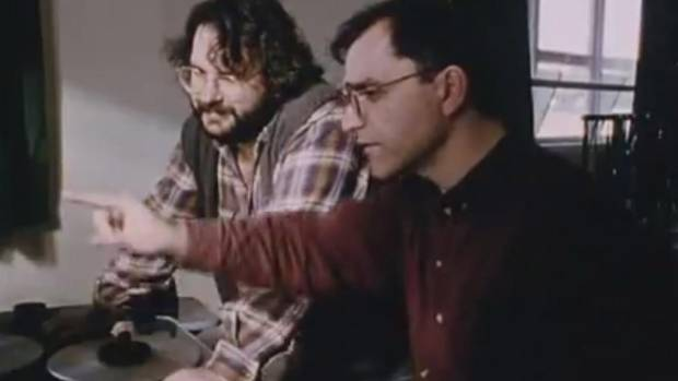 Costa Botes and Peter Jackson check out some of Colin McKenzie's handiwork in a scene from Forgotten Silver.