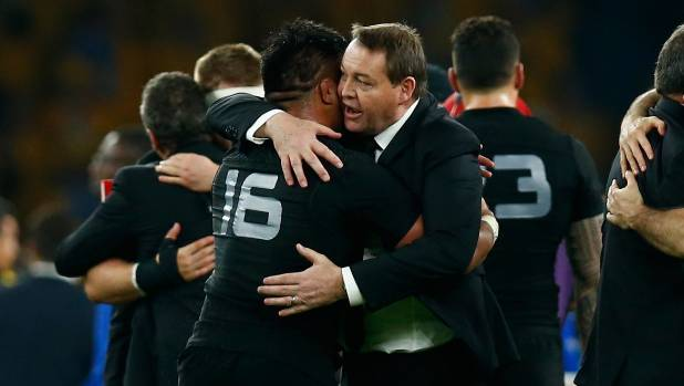 All Blacks coach Steve Hansen shares a moment with his troops after Sunday's Rugby World Cup victory over the Wallabies ...