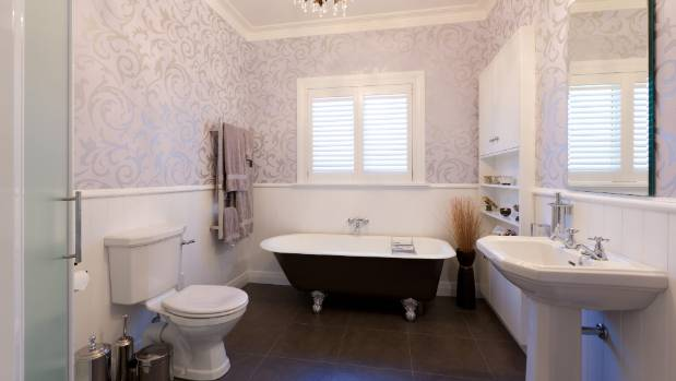 Washable Wallpaper Features In This Renovated Bathroom.