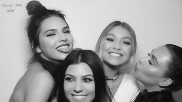 Kendall Jenner (L) celebrates her 20th birthday with sister Kourtney Kardashian, model Gigi Hadid and Kim Kardashian.