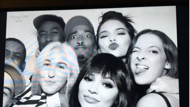 "Little sister Kylie Jenner shared this image from Kendall's birthday photo booth, with the caption ""happy birthday ..."
