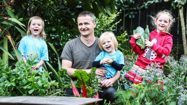 Tim Martin with his children (left to right) Shepard (4), Elijah (2), and Annabella (7) in the garden at their Mt ...
