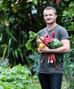 Rhubarb, silverbeet and potatoes grow in profusion in Tim Martin's small, but highly-productive vege garden.