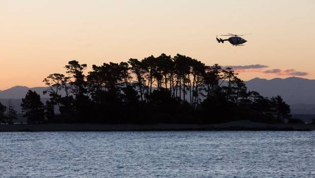 The Nelson Marlborough Rescue Helicopter flies over Haulashore Island after reports of a swimmer in distress.