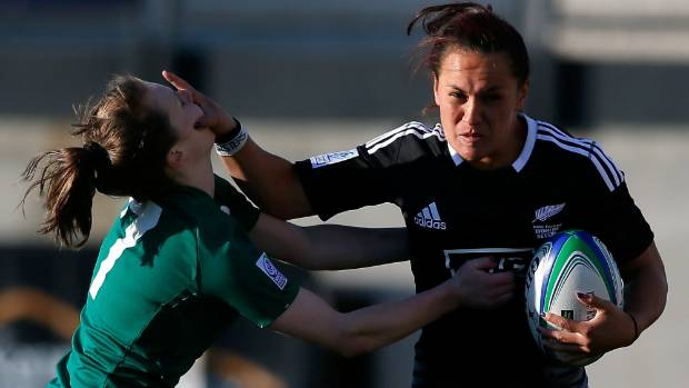 Portia Woodman stiff arms Aoife Doyle of Ireland during the IRB Women's Sevens World Series in 2014.