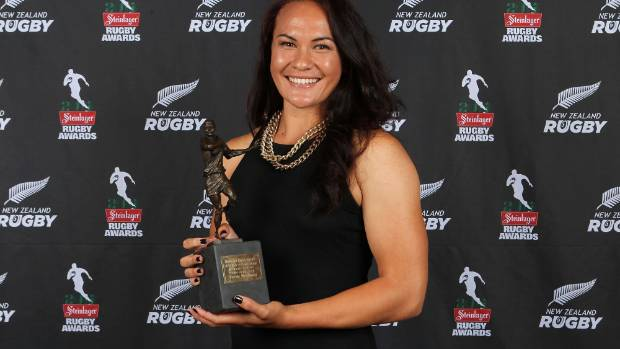 Portia Woodman with her trophy for New Zealand Rugby Women's Sevens Player of the Year at the 2013 Steinlager Rugby Awards.