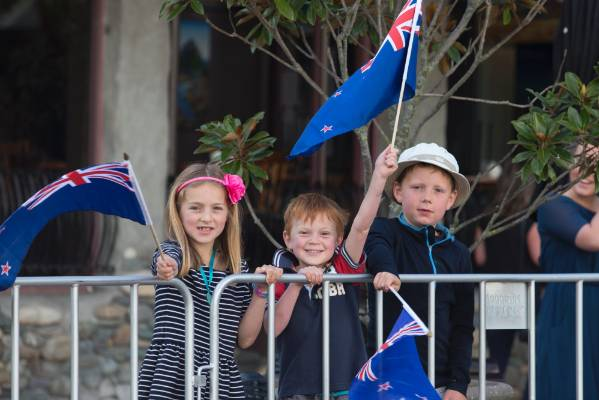Lauren Anderson, left, Ryder Anderson and Ruairidh Cliffin with their flags on Trafalgar St to see Prince Charles and ...