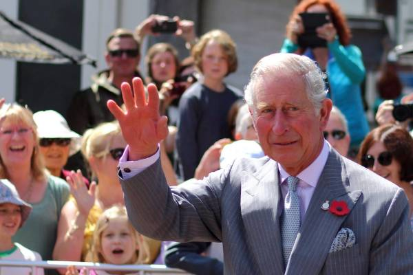 Prince Charles waves to the crowd in Nelson.