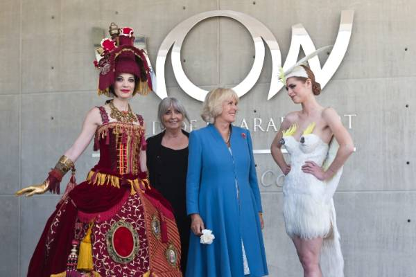 Camilla, Duchess of Cornwall with two models and Suzie Moncrieff during her visit to World of Wearable Art.