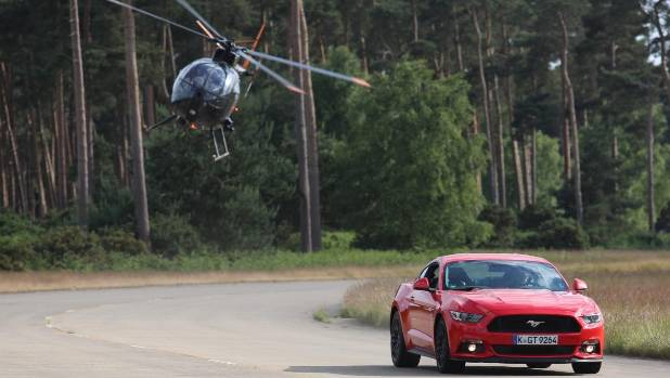 A helicopter tails the new Ford Mustang in a scene from a new Ben Collins movie seeks to find the ultimate stunt car.