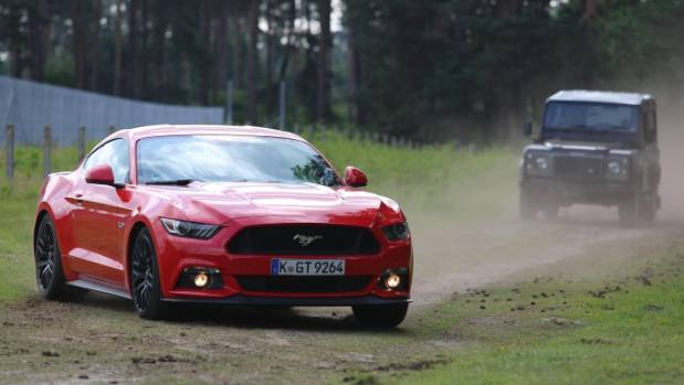A Ford Mustang is pursued by a Land Rover in the movie, Ben Collins: Stunt Driver.