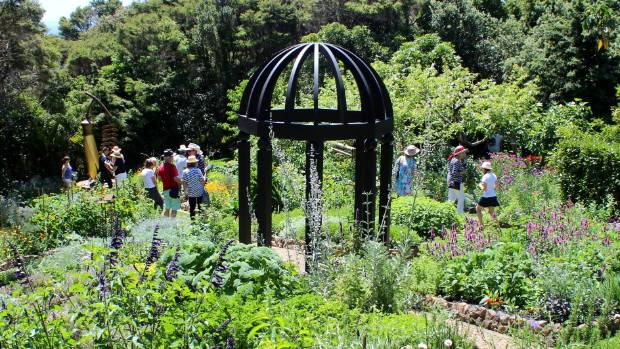 Visitors take their time to meander through the stunning one-acre winning garden during Waiheke Island Garden Safari weekend.