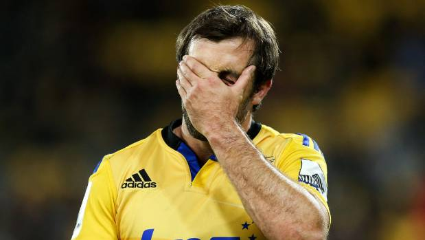 Conrad Smith of the Hurricanes holds his head after returning from a concussion test during a 2015 game against the ...