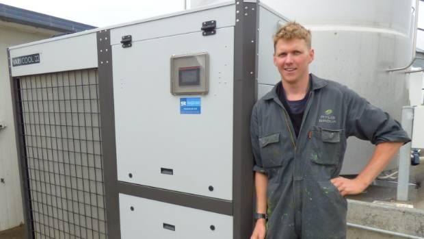Todd Halliday, of Rylib Dairies, mid-Canterbury, with an energy efficient Vari-cool milk chiller.