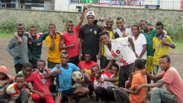 Phoenix Youth squad player Nathanael 'Nati' Hailemariam with street kids in Ethiopia, when he visited his parents' home ...