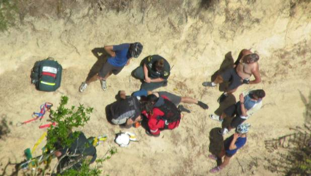An intensive care paramedic treats an injured mountainbiker at the Kaiteriteri  Mountain Bike Park on Sunday.