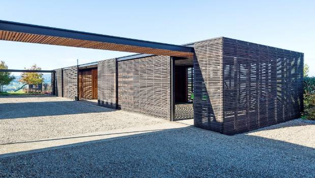 The aesthetic of the timber screens is echoed in another new building on the Clevedon property, which accommodates ...