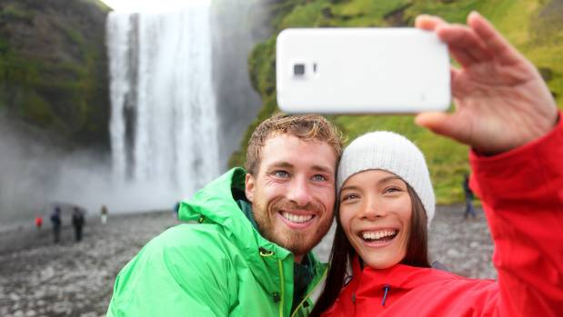 Take selfies while on holiday by all means, but it might be best to post them on social media after you return home, so ...