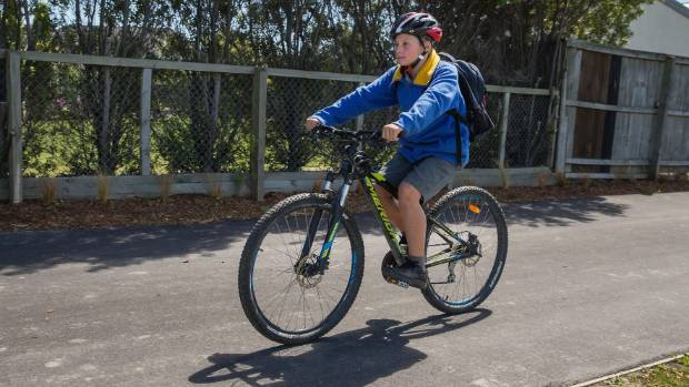Isaac Hutchinson, 11, is one of the few children who rides his bike to school.