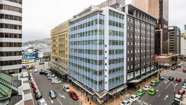 The Leaders Building on the corner of Featherston and Brandon streets will be replaced by a tall wooden structure with ...