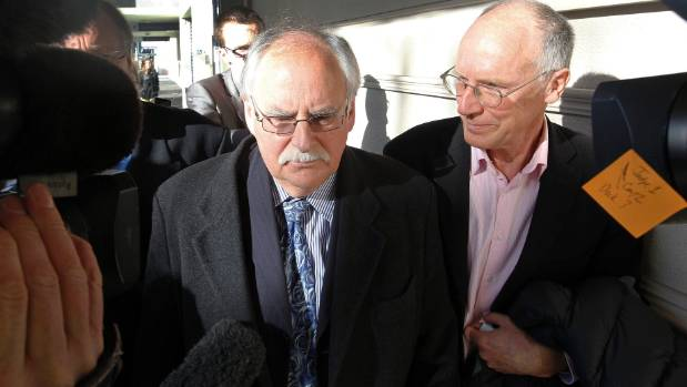 Bruce Tichbon of the Ross Management Investors Group heckles accused fraudster David Ross as he leaves Wellington ...