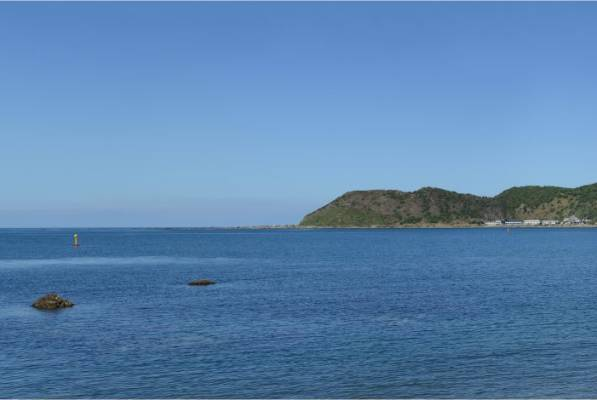 The existing view from Moa Point Beach. Click 'Next' to see what it would look like with an extended runway.