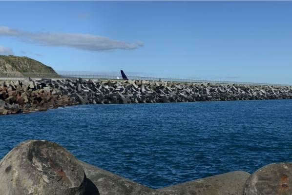 The view from the breakwater on Moa Point Rd with an extended runway.