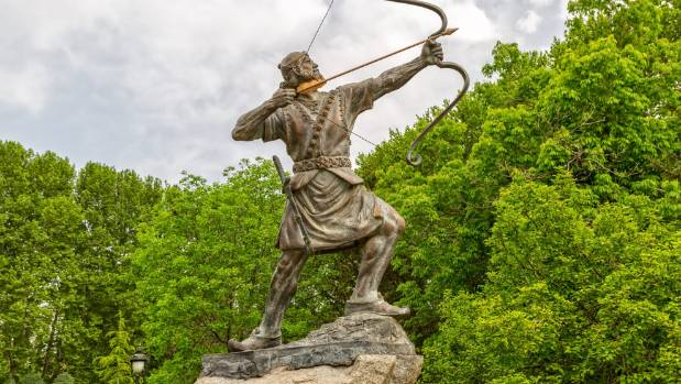 A statue of Aresh Kamangir the Archer in the Niavaran Palace Complex garden.