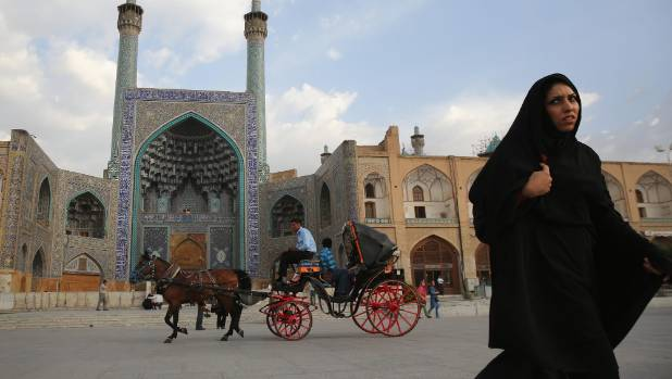 People ride a horse and carriage in Isfahan's Unesco-listed central square.