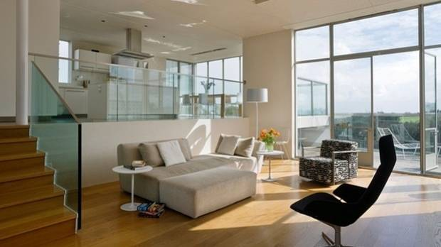 Split-level interiors, or broken-plan living spaces, can provide a welcome degree of separation for family members while ...