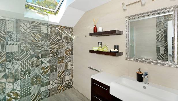 Patterned tiles enliven this bathroom by Designworx.