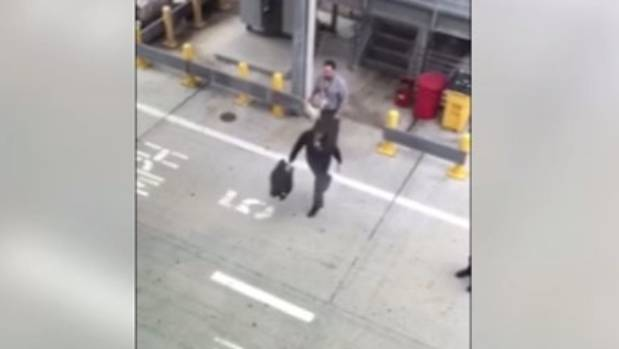 """Alaska Airlines have said in a statement that the suitcase the handlers threw was a """"dummy bag""""."""