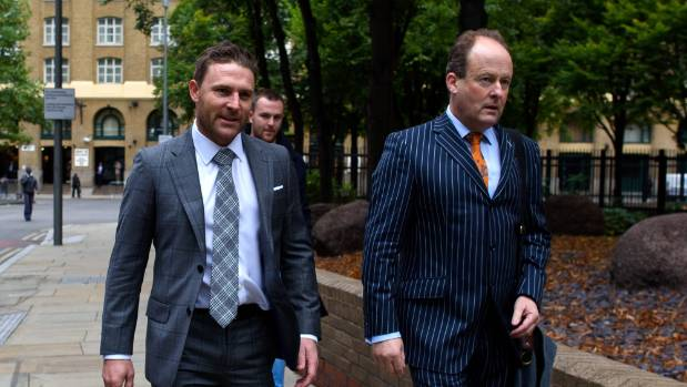 Brendon McCullum, left, arrives at Southwark Crown Court to give evidence in the trial of New Zealand cricketer Chris ...