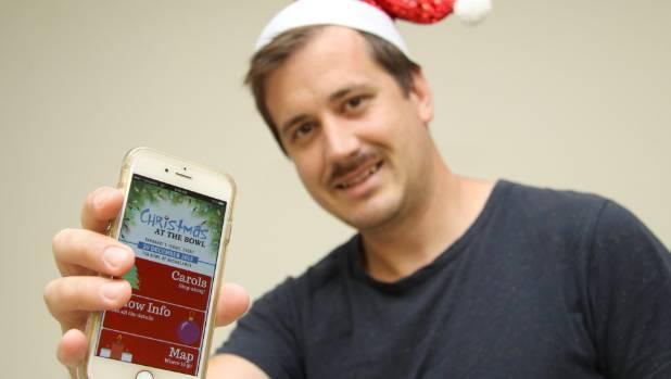 Jordan McFadyen shows off the new Christmas at the Bowl app.
