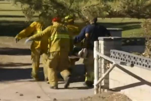 A still image from a video footage courtesy of Nbcla.com shows first responders transporting an injured person at a ...