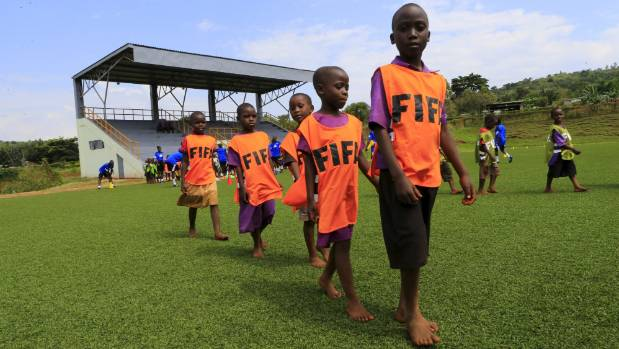 African children chase dreams of a life in Europe by playing a football, a ticket to riches for an athletic few.