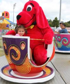 Clifford the Big Red Dog takes a spin on the teacups at this year's Fun Fest.