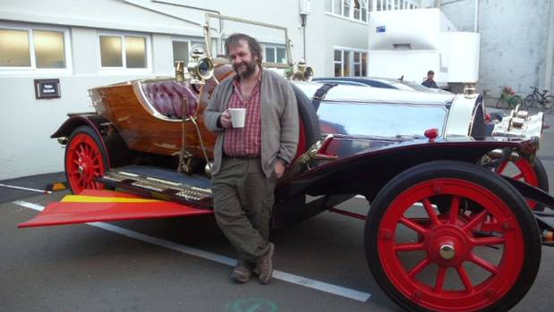 Sir Peter Jackson with Chitty Chitty Bang Bang, an item from his movie collection that will be housed in the new Movie ...