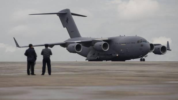 A Royal Australian Air Force (RAAF) C-17 Globemaster III transport plane carrying donated aid for Myanmar's flood ...